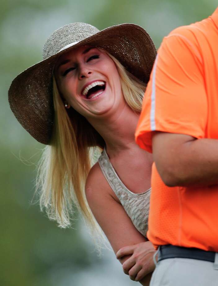 Skier Lindsey Vonn laughs while watching Tiger Woods during the first round of the Masters golf tournament Thursday, April 11, 2013, in Augusta, Ga. Photo: Darron Cummings, Associated Press / AP