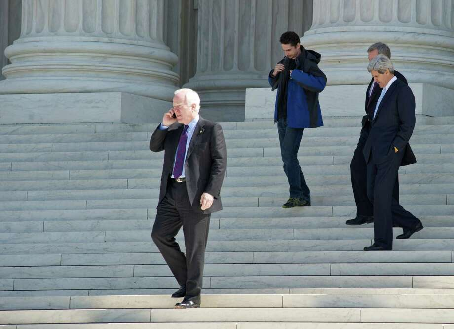 John Cornyn and John Kerry descend the steps of the US Supreme Court in Washington after the morning session on March 27, 2012. Photo: Karen Bleier, Getty Images / AFP