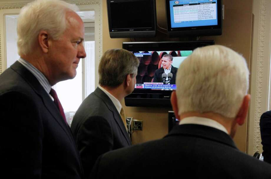 Sen. John Cornyn, Sen. John Hoeven, R-N.D., and Sen. Richard Lugar, R-Ind. watch a monitor as President Barack Obama speaks about the Keystone XL pipeline live from Cushing, Okla., before their news conference on the same subject, Thursday, March 22, 2012, on Capitol Hill in Washington. Photo: Charles Dharapak, The Associated Press / AP