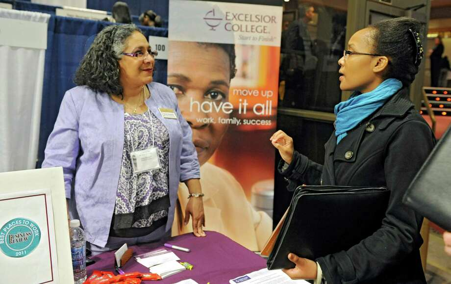 Sherly Henriques from human resource office at Excelsior College, left, talks to job seeker Rebecca Ratemo of Albany during the Dr. Martin Luther King Jr. Career Fair at the Empire State Plaza Convention Center on Thursday, April 11, 2013 in Albany, N.Y. (Lori Van Buren / Times Union) Photo: Lori Van Buren