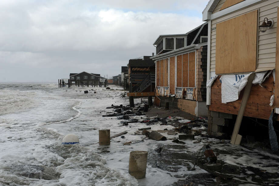 Damage to beach front homes in the Lordship section of Stratford, Conn. following Hurricane Sandy Oct. 30th, 2012. Photo: Ned Gerard / Connecticut Post