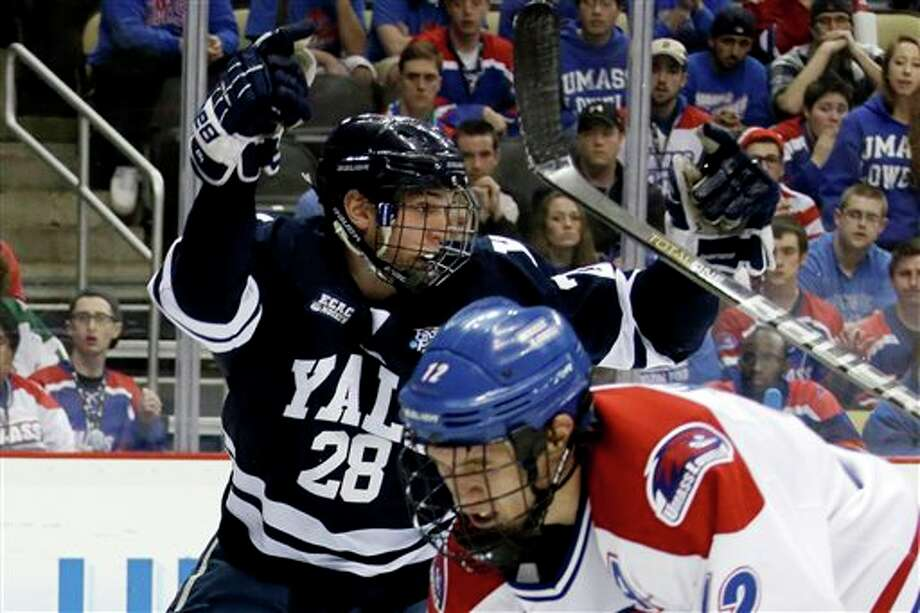 Yale right wing Antoine Laganiere (28) celebrates his first-period goal against UMass Lowell goalie Connor Hellebuyck during an NCAA Frozen Four college hockey semifinal in Pittsburgh, Thursday, April 11, 2013. Photo: Gene Puskar, AP / AP