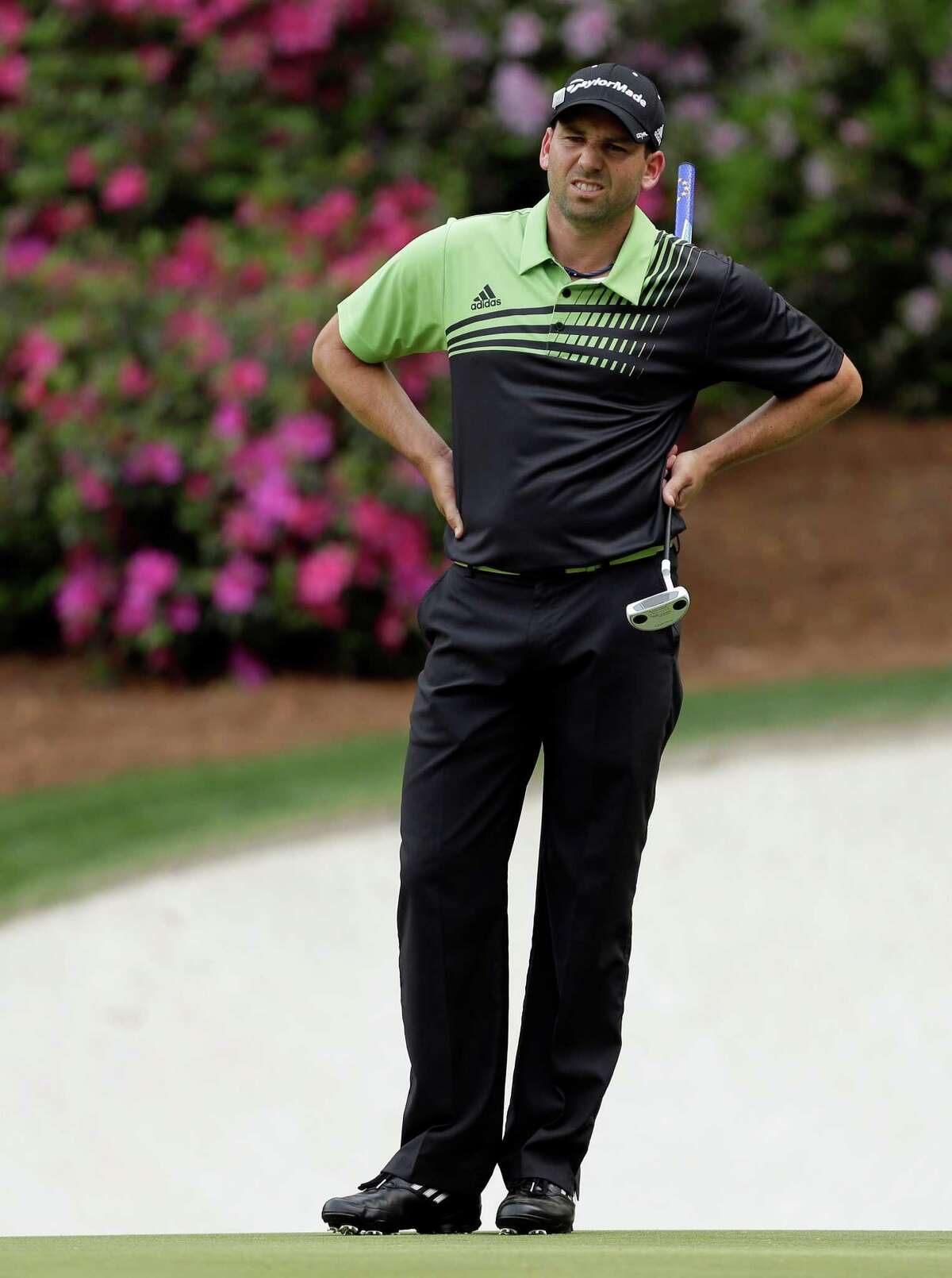 Sergio Garcia, of Spain, reacts to a missed putt on the 13th green during the first round of the Masters golf tournament Thursday, April 11, 2013, in Augusta, Ga.