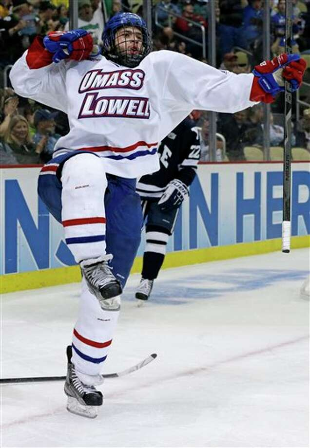 UMass Lowell center Joseph Pendenza celebrates his second-period goal during  an NCAA college hockey game against Yale in Pittsburgh Thursday, April 11, 2013. Photo: Gene Puskar, AP / AP