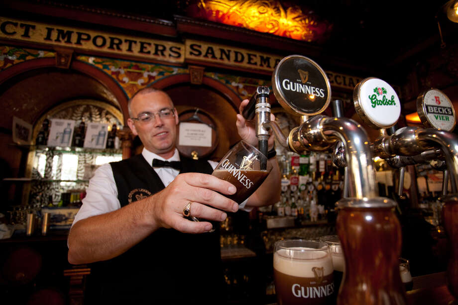 Never rush your bartender when he's pouring a Guinness. It takes time — almost sacred time. Photo: Dominic Bonuccelli, Ricksteves.com / dominic arizona bonuccelli / azfoto.com