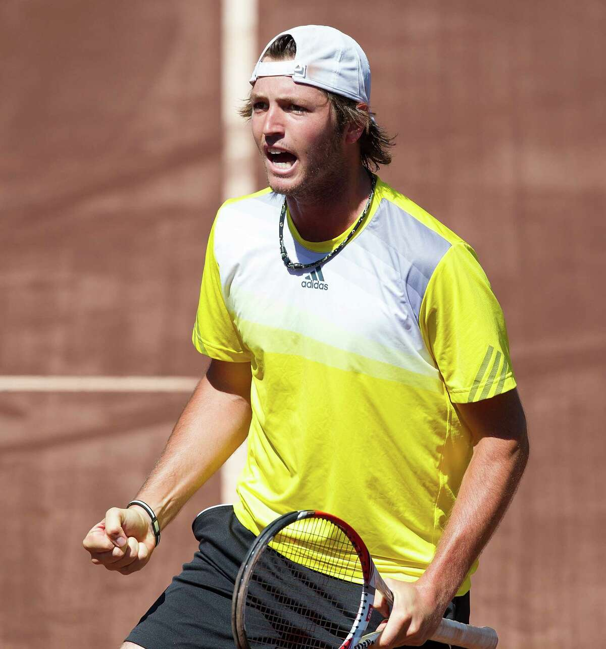 Rhyne Williams reacts after a win during the U.S. Men's Clay Court Championships.