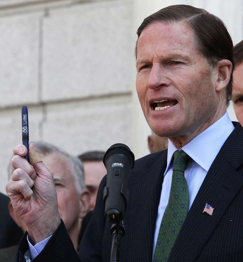 Sen. Richard Blumenthal, D-Conn., displays one of the pens Gov. Dannel P. Malloy used Thursday to sign new state gun legislation on the steps of Hartford Conn., City Hall Friday April 5, 2013, as Blumenthal joined others to urge passage of federal legislation to curb gun violence. (AP Photo/Journal Inquirer, Jared Ramsdell) MANDATORY CREDIT Photo: Jared Ramsdell, Associated Press / Journal Inquirer