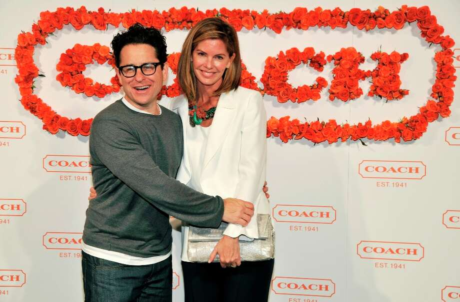 Hosts J.J. Abrams, left, and his wife Katie McGrath pose together at the 3rd Annual Coach Evening to Benefit Children\'s Defense Fun at Bad Robot on Wednesday, April 10, 2013 in Santa Monica, Calif. (Photo by Chris Pizzello/Invision/AP) Photo: Chris Pizzello, Associated Press / Invision
