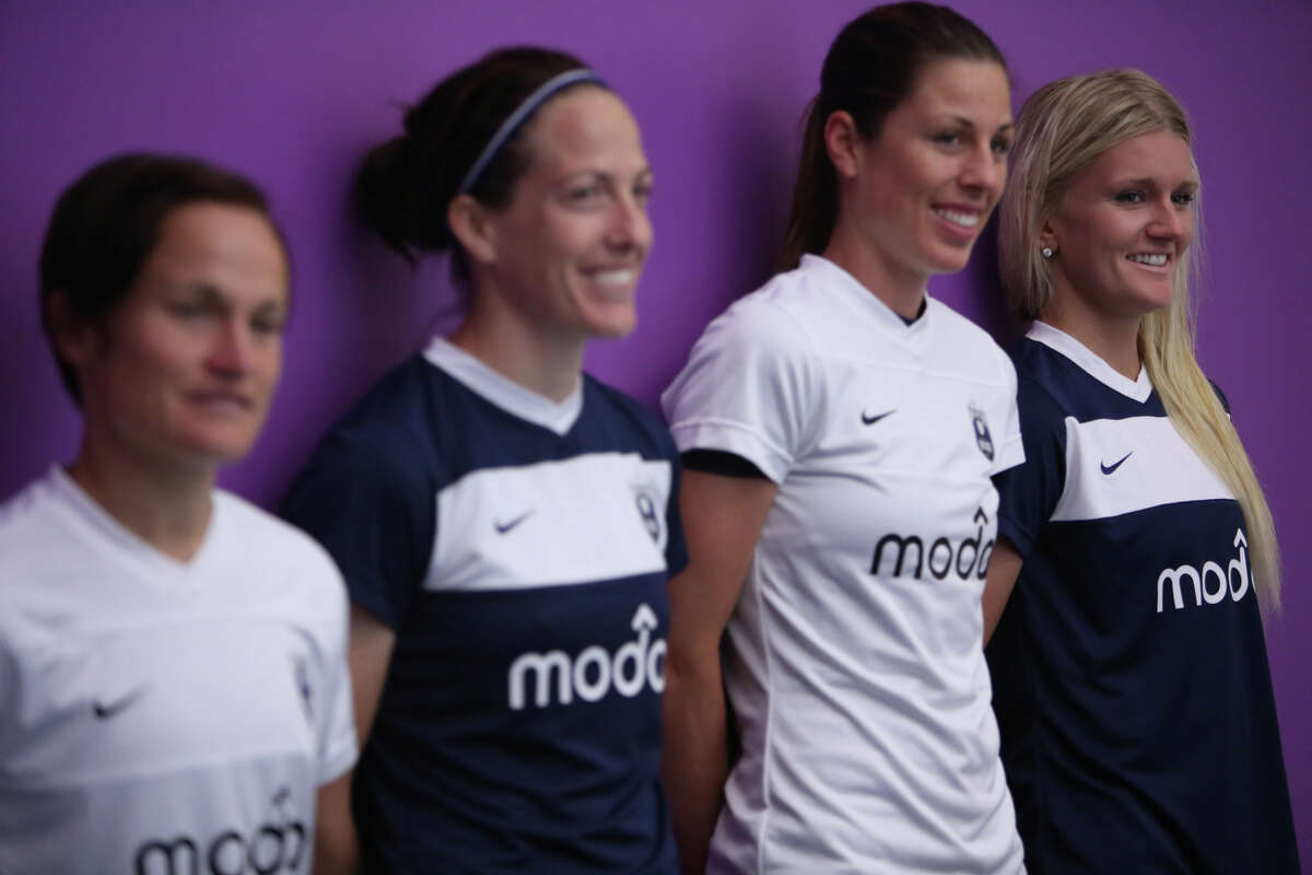 From left, Seattle Reign players Lyndsey Patterson, Liz Bogus, Emily Zurrer and Kaylyn Kyle unveil the new team's kit on April 11, 2013 at Starfire Sports in Tukwila. The new team kicks off their inaugural season with an away game against Chicago this weekend. Their first home game will be on May 4th at Starfire in Tukwila.