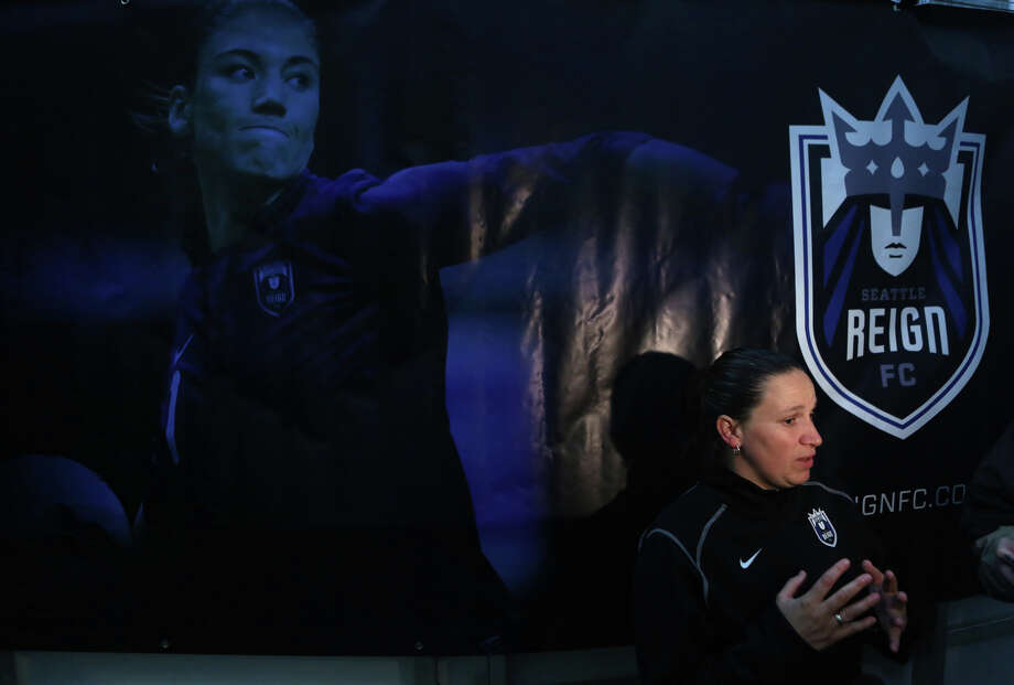 Seattle Reign head coach and general manager Laura Harvey speaks to media under a banner featuring injured player Hope Solo during practice at Starfire Sports in Tukwila. The new team kicks off their inaugural season with an away game against Chicago this weekend. Their first home game will be on May 4th at Starfire in Tukwila. Photo: JOSHUA TRUJILLO, SEATTLEPI.COM / SEATTLEPI.COM