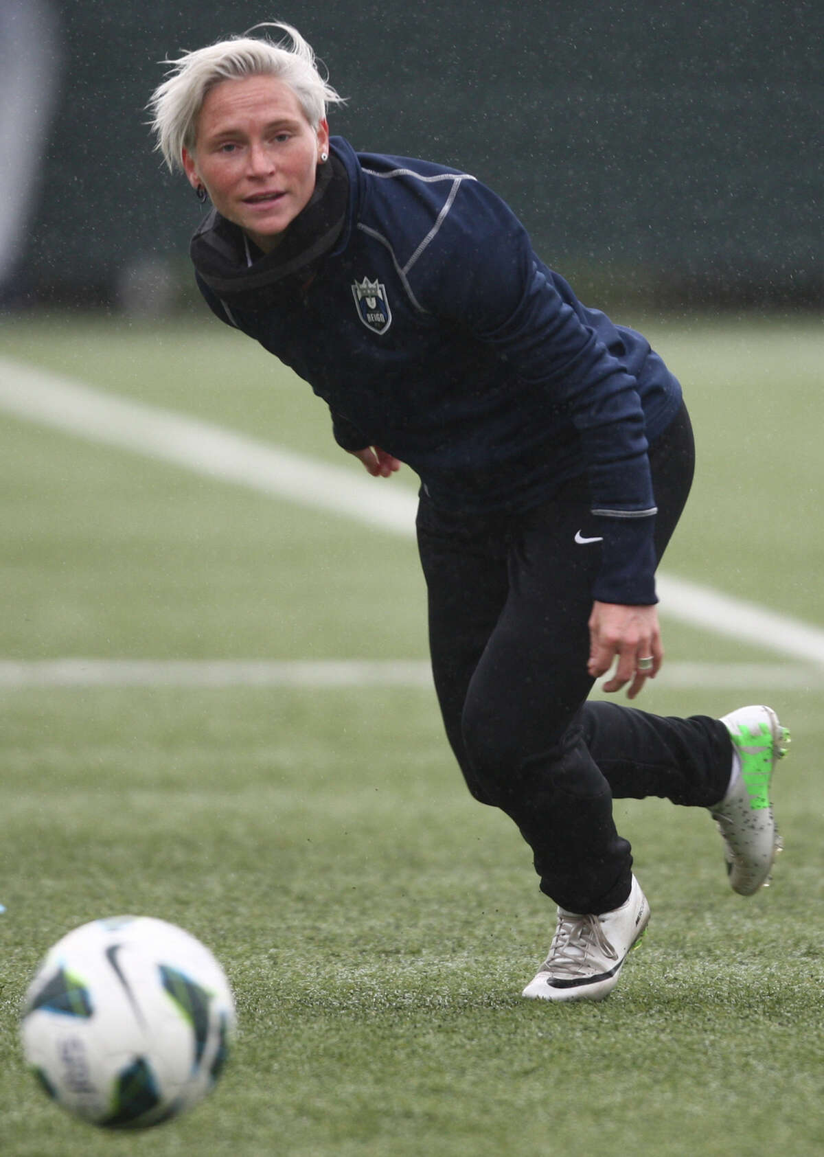 Seattle Reign player Jess Fishlock chases a ball during practice.