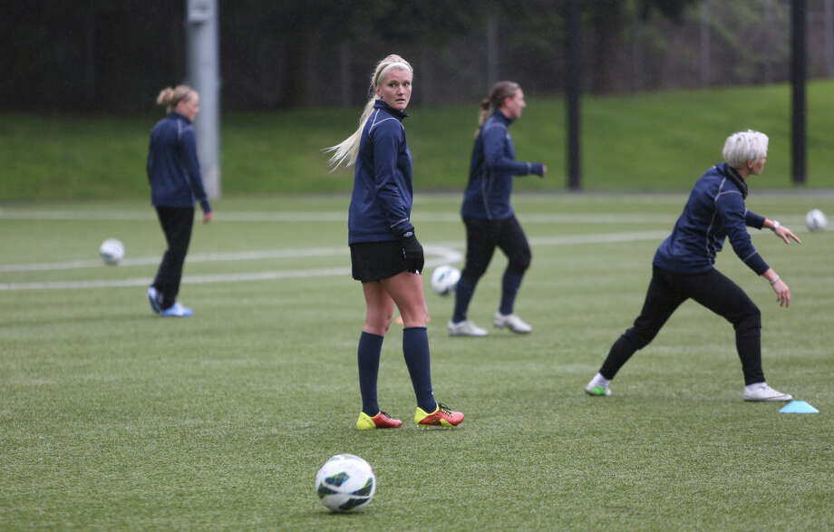 Players, including Kaylyn Kyle run drills during Seattle Reign practice at Starfire Sports in Tukwila. Photo: JOSHUA TRUJILLO, SEATTLEPI.COM / SEATTLEPI.COM
