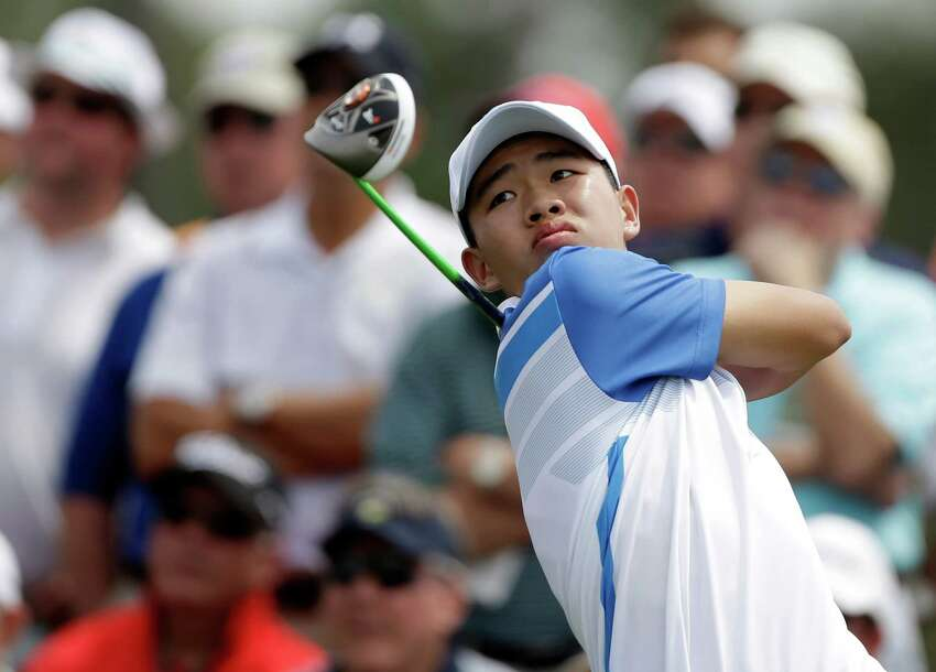 Amateur Guan Tianlang, of China, tees off on the eighth hole during the first round of the Masters golf tournament Thursday, April 11, 2013, in Augusta, Ga.