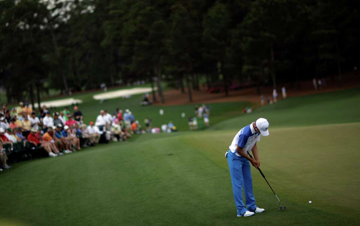 Amateur Guan Tianlang, of China, putts on the ninth green during the first round of the Masters golf tournament Thursday, April 11, 2013, in Augusta, Ga.