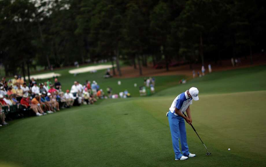 Amateur Guan Tianlang, of China, putts on the ninth green during the first round of the Masters golf tournament Thursday, April 11, 2013, in Augusta, Ga. Photo: David Goldman