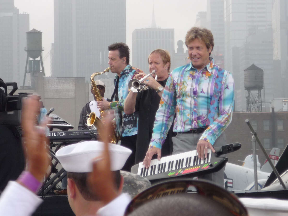 With New York City as a backdrop, Walter Parazaider (from left), Lee Loughnane and Robert Lamm, original members of the band Chicago, appear on CBS' Early Show June 19, 2009, on the flight deck of the USS Intrepid Museum.