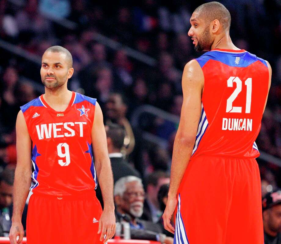 The West's Tony Parker and Tim Duncan pause during a timeout in first half action of the 62nd NBA All-Star Game at the Toyota Center on Sunday, Feb. 17, 2013 in Houston. Photo: Edward A. Ornelas, San Antonio Express-News / © 2013 San Antonio Express-News