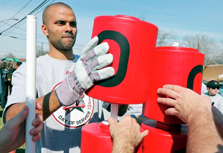 The Spurs' Tony Parker helps volunteers construct the 5th Ward Legends Playspace on Friday, Feb. 15, 2013 in Houston. The event is part of the NBA All-Star weekend. Photo: Edward A. Ornelas, San Antonio Express-News / © 2013 San Antonio Express-News