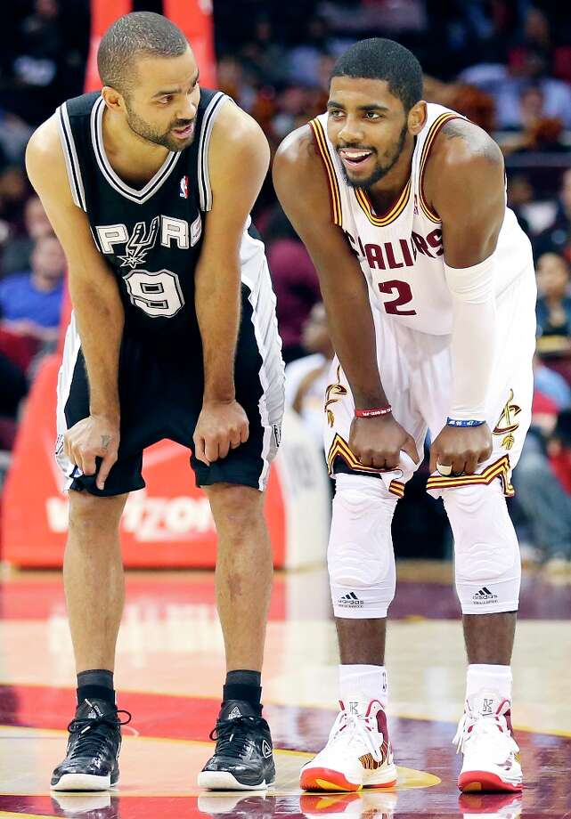 The Spurs' Tony Parker talks with Cleveland Cavaliers' Kyrie Irving during second half action Wednesday, Feb. 13, 2013 at the Quicken Loans Arena in Cleveland, Ohio. The Spurs won 96-95. Photo: Edward A. Ornelas, San Antonio Express-News / © 2013 San Antonio Express-News