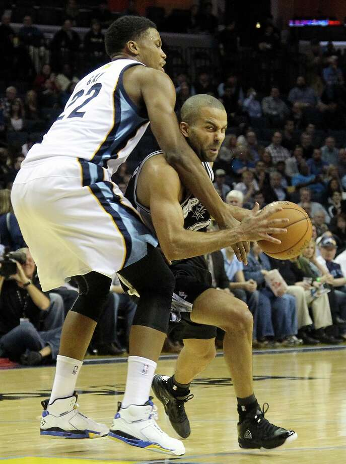Memphis Grizzlies forward Rudy Gay (22) fouls Spurs guard Tony Parker in the first half on Friday, Jan. 11, 2013, in Memphis, Tenn. Photo: Lance Murphey, Associated Press / FR78211 AP