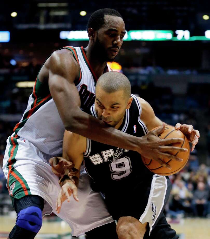 The Spurs' Tony Parker (9) tries to drive past Milwaukee Bucks' Luc Richard Mbah a Moute during the second half Wednesday, Jan. 2, 2013, in Milwaukee. Photo: Morry Gash, Associated Press / AP
