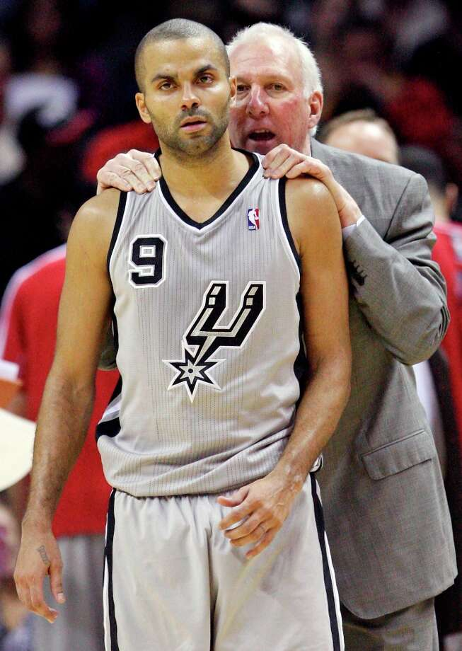 Spurs coach Gregg Popovich talks with Tony Parker during the start of overtime with the Memphis Grizzlies on Saturday, Dec. 1, 2012 at the AT&T Center. Spurs won 99-95. Photo: Edward A. Ornelas, San Antonio Express-News / © 2012 San Antonio Express-News