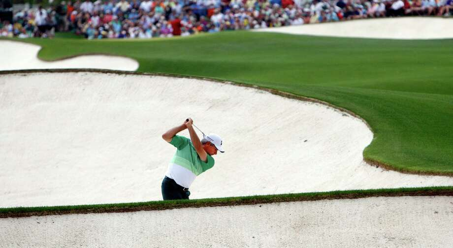 Fred Couples hits from the fairway bunker on the 18th hole during the first round of the Masters at Augusta National Golf Club in Augusta, Georgia, Thursday, April 11, 2013. (Tim Dominick/The State/MCT) Photo: Tim Dominick, McClatchy-Tribune News Service / The State