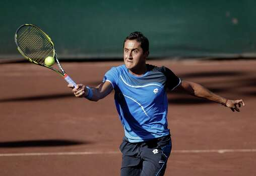 Nicolas Almagro, of Spain, during action against Gael Monfils, of France ,Thursday, April 13, 2013 at the U.S. Mens Clay Court Championships in Houston, Texas. Almagro, the number one seed defeated Monfils 2-6,6-0,6-3. Photo: Bob Levey, Houston Chronicle / ©2013 Bob Levey