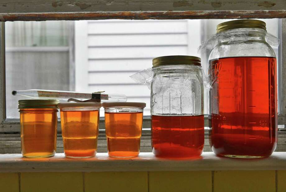 Some of this seasons maple syrup made by Billy Stanley from trees in his city of Albany neighborhood Friday March 22, 2013. (John Carl D'Annibale / Times Union) Photo: John Carl D'Annibale / 00021676A