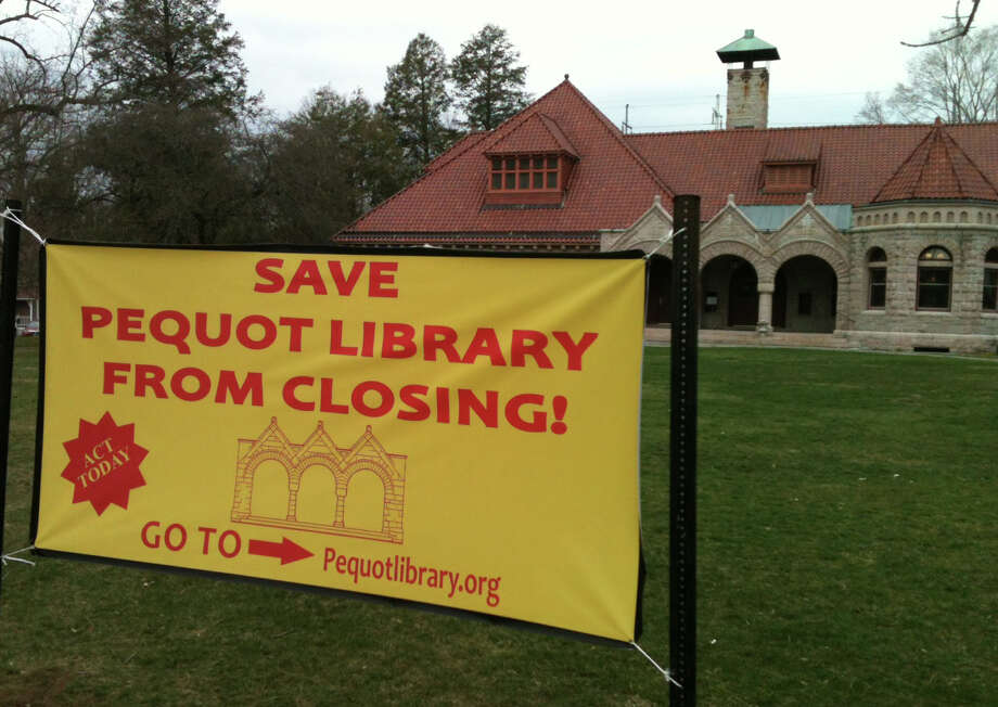 A sign urging people to sign an online petition in support of the Pequot Library's bid to win restoration of $350,000 in town funding has been erected in front of the Southport library.  FAIRFIELD CITIZEN, CT 4/10/13 Photo: Andrew Brophy / Fairfield Citizen contributed
