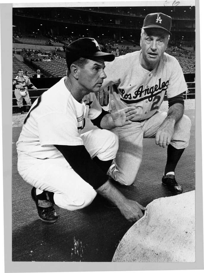 Grady Hatton and Dodgers manager Walter Alston inspect the Astrodome's new artificial surface in 1966. Photo: BLAIR PITTMAN, HC Staff / Houston Chronicle