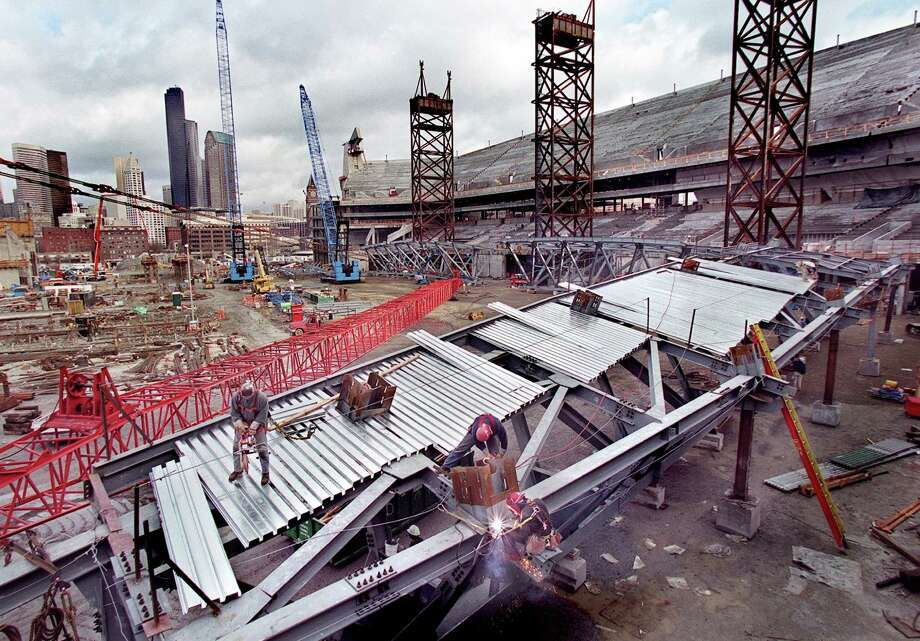 Iron workers assemble a 130-foot-long truss Feb. 2, 2001. It would be lifted on top of three temporary shoring towers as part of the beginning of the east side of the new Seahawks Stadium roof. Photo: Renee C. Byer, Seattlepi.com File
