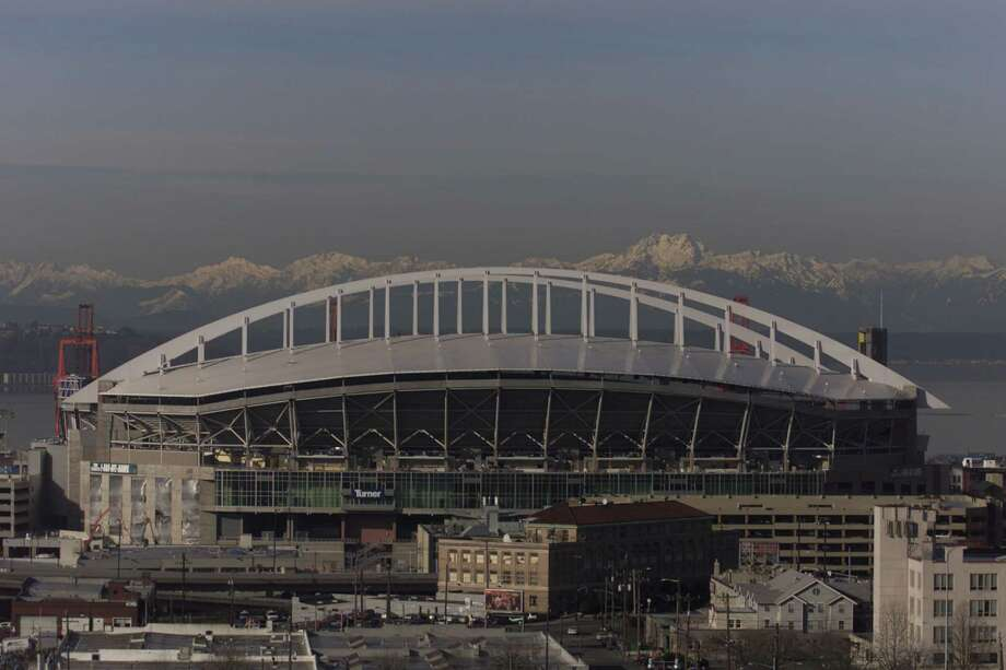"The Seahawks Stadium's white ""rainbow"" roof fills the vacancy in the city's skyline once occupied by the Kingdome. Photo: Corky Trewin, Seattle Seahawks"