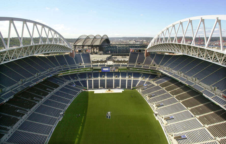 File photo - The then-new Seattle Seahawks stadium is seen from atop the north tower, looking south toward Safeco Field, on July 18, 2002.  Keep clicking for photos of CenturyLink Field through the years... Photo: Elaine Thompson, Associated Press / AP