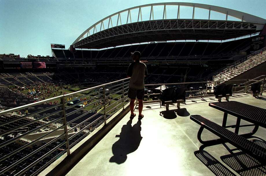 A perspective season ticket holder looks over Seahawks Stadium durring the open house July 21, 2002, before the grand opening. Photo: Loren Callahan, Seattlepi.com File