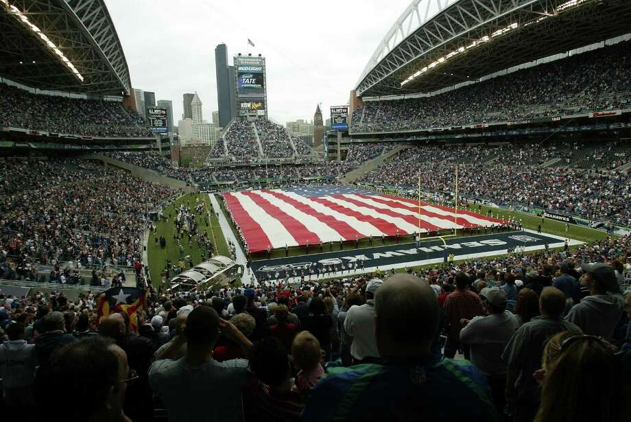 The American flag covers the Seahawks Stadium field during the home opener for new stadium on Sept. 15, 2002. Photo: Paul Kitagaki Jr., Seattlepi.com File