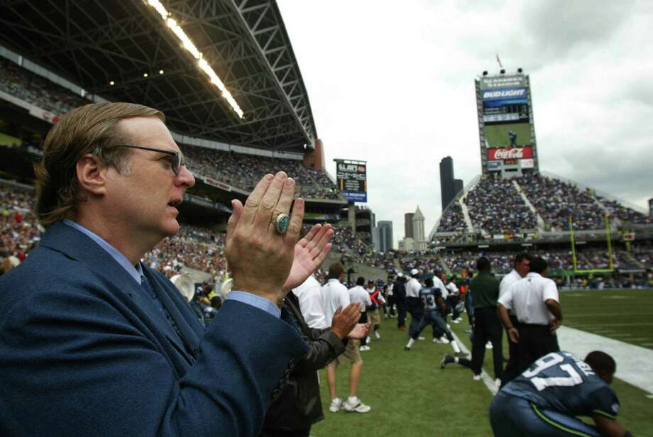 Paul Allen, owner of the Seahawks, applauds his team in the first few minutes of play against Arizona during the first regular season game at the new Seahawks Stadium on Sept. 15, 2002. Photo: Dan DeLong, Seattlepi.com File