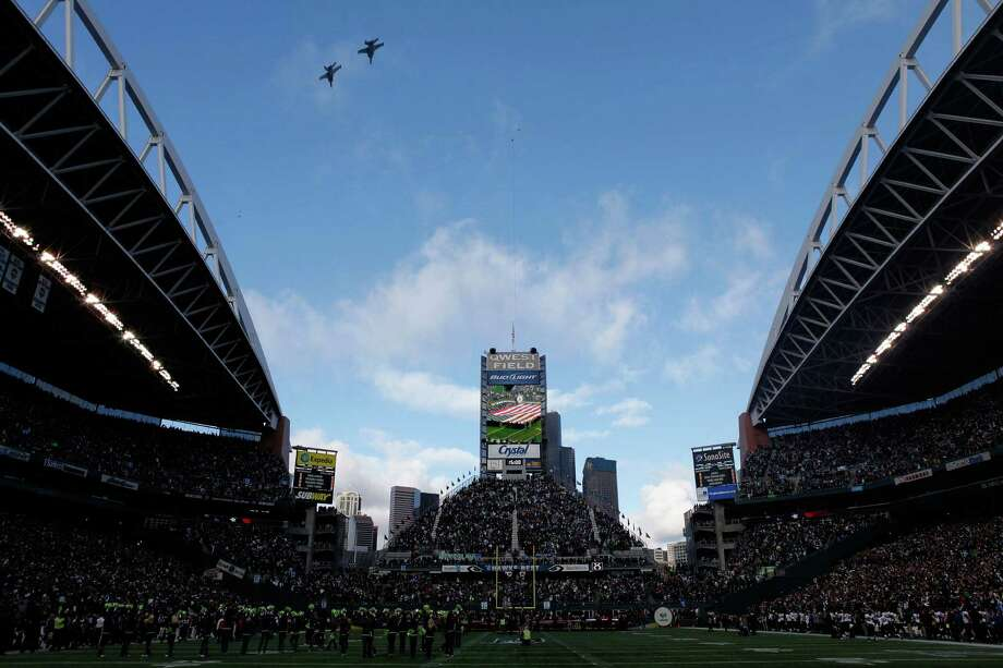 A flyover before the 2011 NFC wild-card playoff game between the New Orleans Saints and the Seattle Seahawks at Qwest Field on Jan. 8, 2011. Marshawn Lynch's famous earth-shaking run would occur within hours. Photo: Jonathan Ferrey, Getty Images / 2011 Getty Images