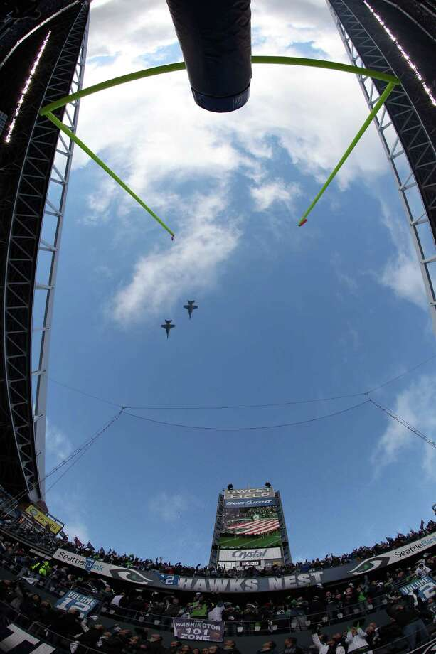 A flyover before the 2011 NFC wild-card playoff game between the New Orleans Saints and the Seattle Seahawks at Qwest Field on Jan. 8, 2011. Photo: Otto Greule Jr., Getty Images / 2011 Getty Images