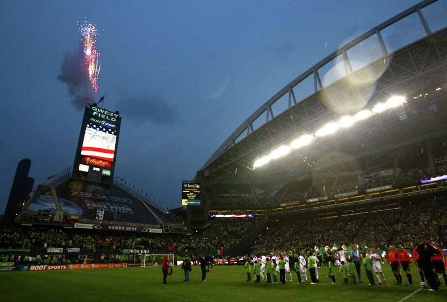 Fireworks erupt as the Seattle Sounders and L.A. Galaxy prepare to take the field for the 2011 MLS season opener on March 15, 2011, at Qwest Field. Photo: Joshua Trujillo, Seattlepi.com / Seattlepi.com