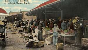 Vintage postcard showing vendors selling produce to customers from the outdoor stalls at the Public Market circa 1911.