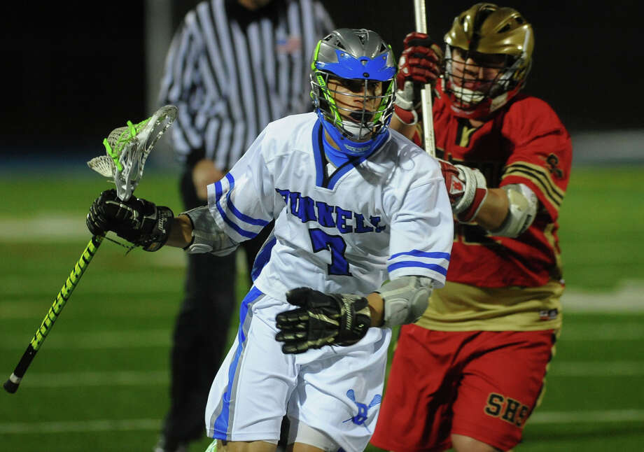Bunnell's Andrew Calzone drives the ball as Stratford's Connor Bodington follows, during boys lacrosse action in Stratford, Conn. on Thursday April 11, 2013. Photo: Christian Abraham / Connecticut Post