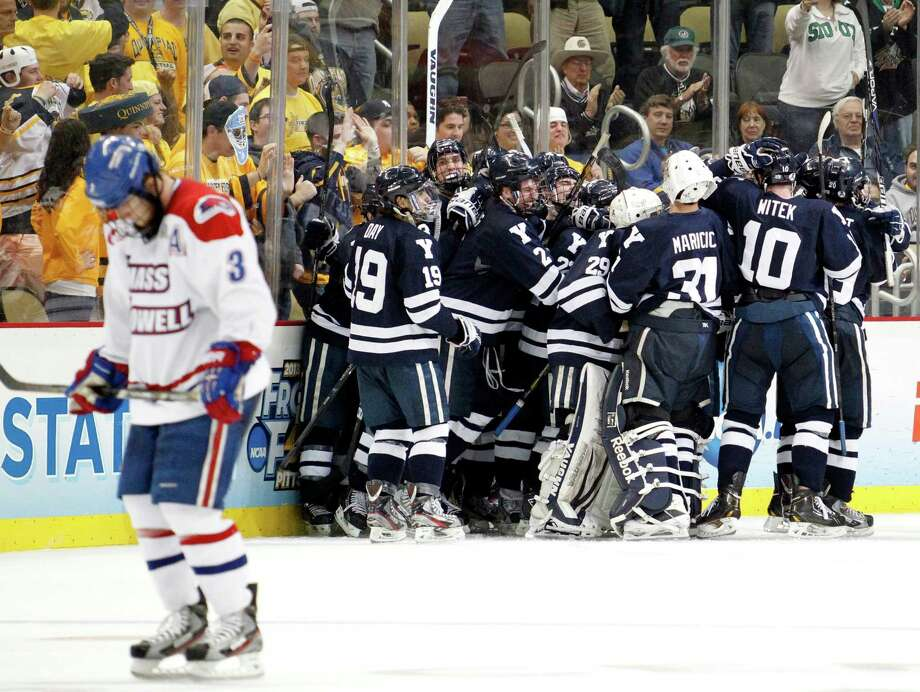 PITTSBURGH, PA - APRIL 11: Andrew Miller #17 of the Yale Bulldogs celebrates his game winning overtime goal against the UMass Lowell Riverhawks during the game at Consol Energy Center on April 11, 2013 in Pittsburgh, Pennsylvania. Yale defeated UMass Lowell Riverhawks 3-2 in overtime. (Photo by Justin K. Aller/Getty Images) Photo: Justin K. Aller, Getty Images / 2013 Getty Images