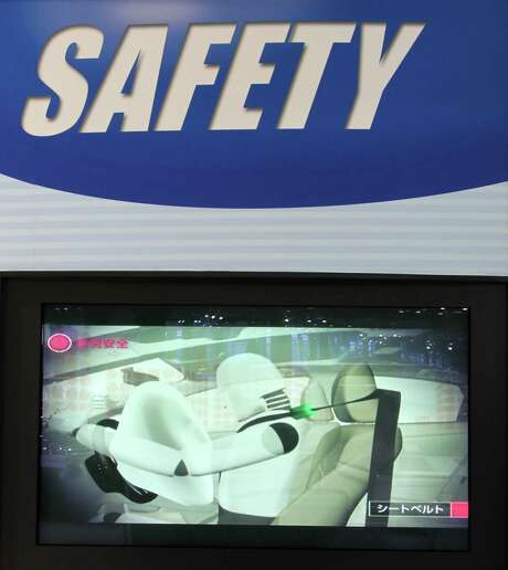 Takata Corp. faces its biggest recall in two decades after defective airbag inflators led to the recall of more than 3 million vehicles. A screen displays a video on airbag safety. Photo: Koichi Kamoshida / Bloomberg