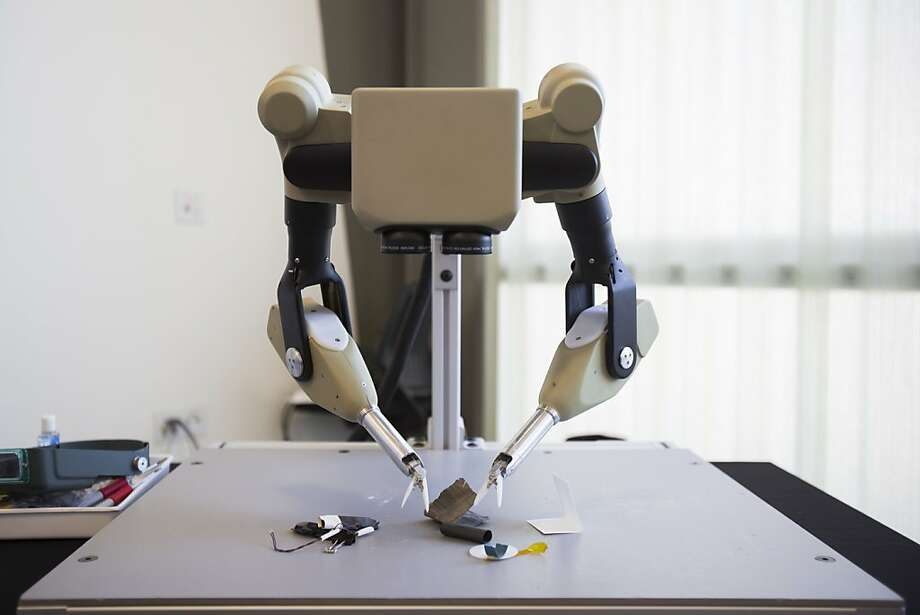 SRI International's Taurus dexterous robot can grasp and move objects. Photo: Stephen Lam, Special To The Chronicle