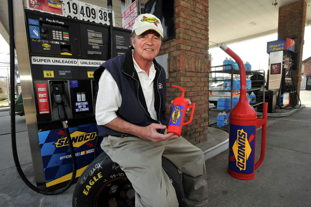 Bob Basche, former chairman of Millsport and current founder and pricipal of Connect Sports and Entertainment based in Stamford, displays a promotional water bottle that is fashioned after a NASCAR/Sunoco gas can at the Sunoco station on Post Road in Darien on Wednesday, April 10, 2013. His plan is to sell the bottles at Sunoco retailers and at NASCAR events.