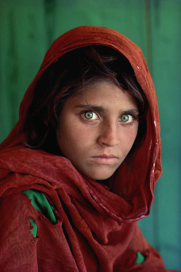 "A 30-year retrospective honoring photojournalist Steve McCurry takes place through May 6 at Cavalier Galleries in Greenwich. Above is his ""Afghan Girl"" for the cover of National Geographic -- one of the magazine's most popular images of all time. Photo: Contributed Photo / Connecticut Post Contributed"