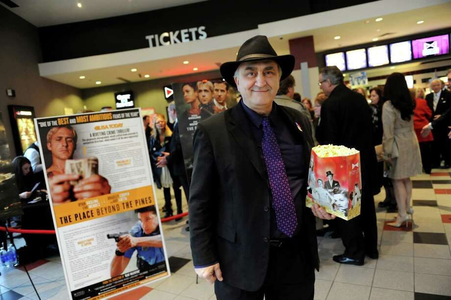 "Don Rittner, Schenectady County historian, center, has his popcorn and is ready to watch the premiere of ""Place Beyond the Pines"" on Thursday, April 11, 2013, at Bow-Tie Cinema Movieland 6 in Schenectady , N.Y. (Cindy Schultz / Times Union) Photo: Cindy Schultz / 10021921A"