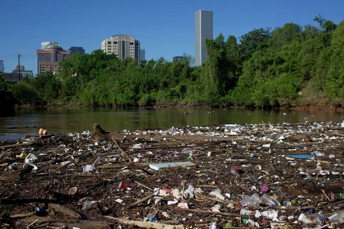Plastic bottles, Styrofoam cups and other garbage create a debris field along the shoreline of Buffalo Bayou just northeast of downtown Houston.