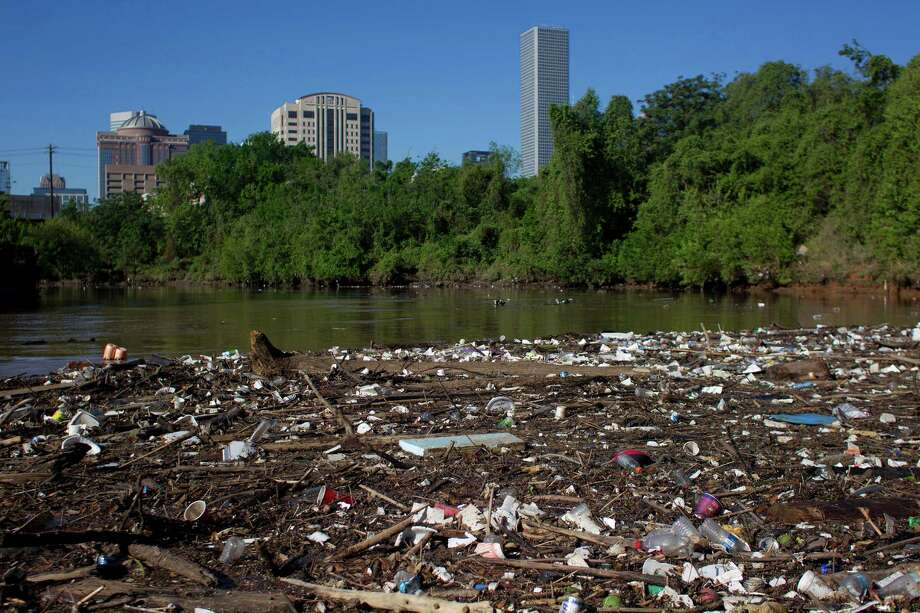 Plastic bottles, Styrofoam cups and other garbage create a debris field along the shoreline of Buffalo Bayou just northeast of downtown Houston. Photo: Johnny Hanson, Staff / © 2013  Houston Chronicle